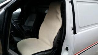100% fur Capes on the car seat. Covers made of sheepskin, Kohli